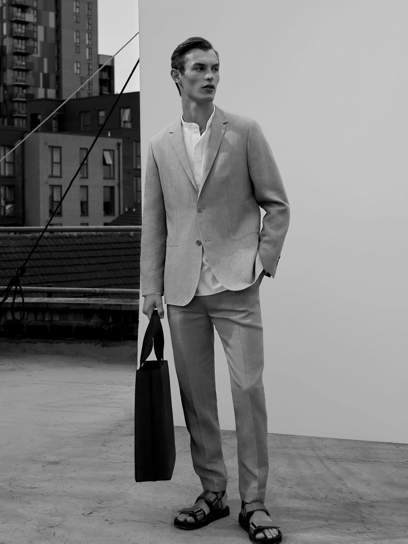 Front and center, Kit Butler dons a linen suit from COS.