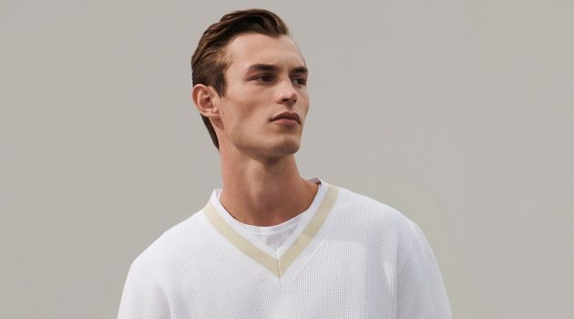 A smart vision in white, Kit Butler models a chic look from COS' 'To the Sea' collection.