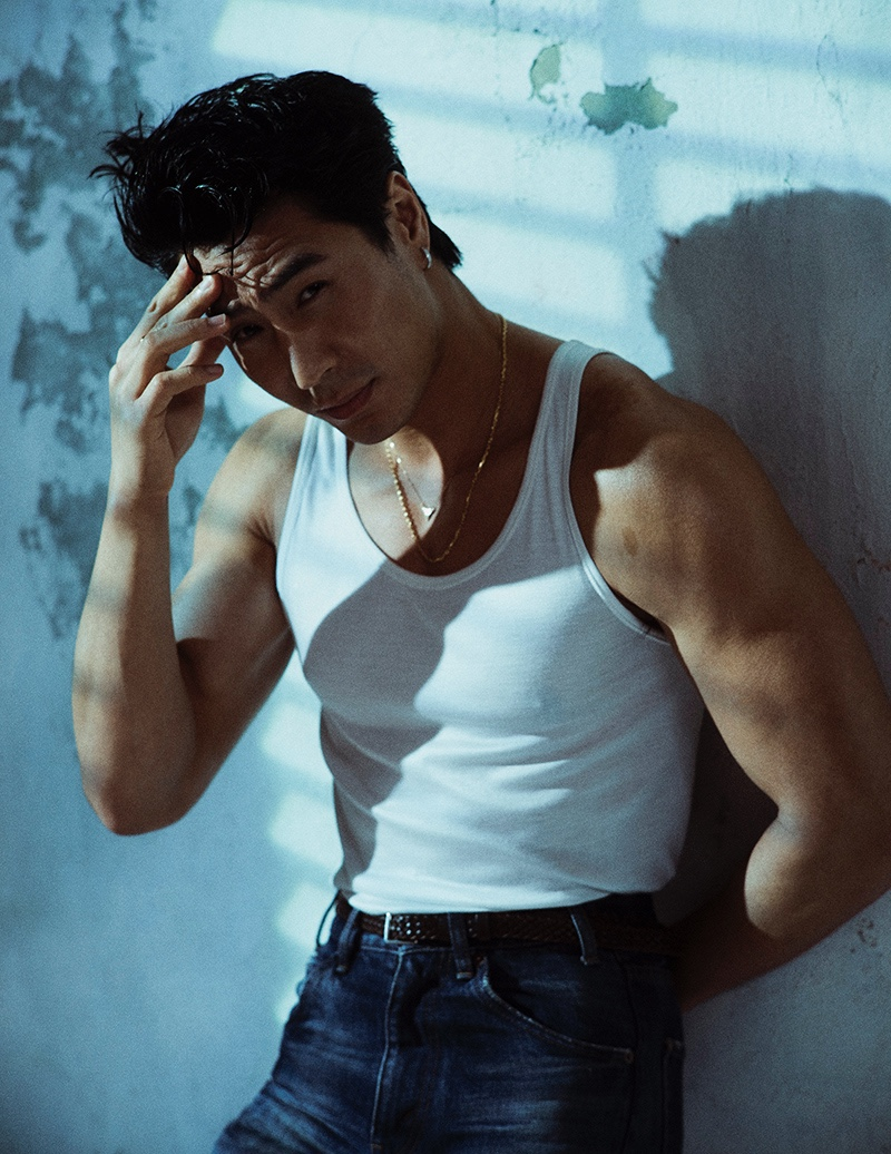Actor Chris Pang dons a tank, jeans, and leather belt by Celine for Esquire Singapore.