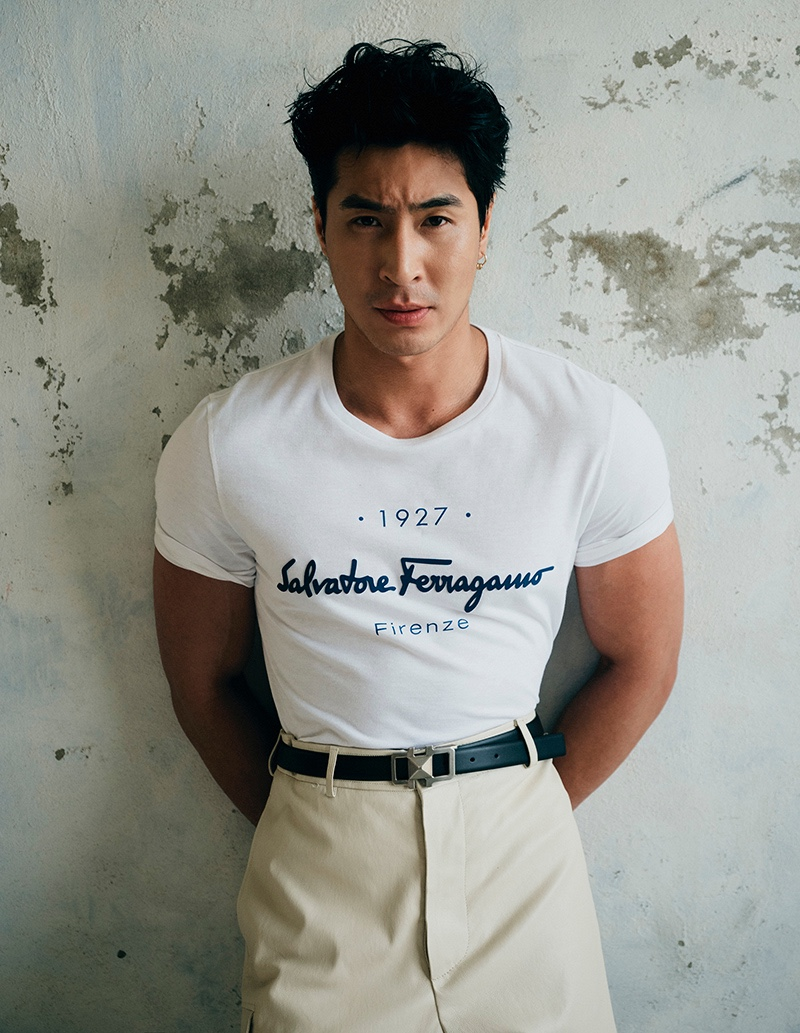 Front and center, Chris Pang wears a t-shirt with leather pants and a belt by Salvatore Ferragamo for Esquire Singapore.