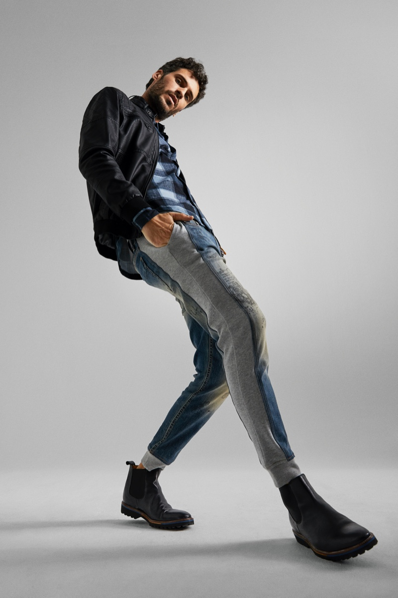 Florent Lahmeri models a pair of Desigual's hybrid denim joggers.