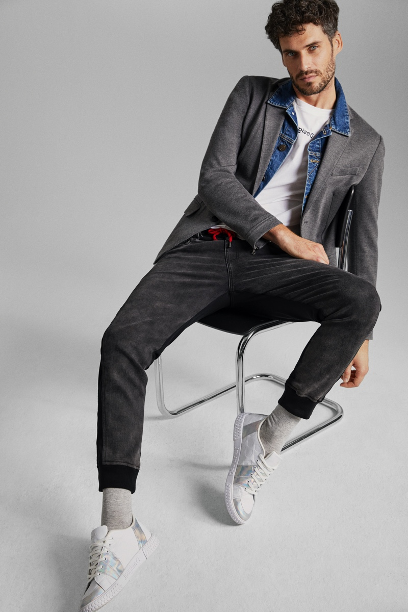 Denim and gray cotton come together as Florent Lahmeri models a look from Desigual's hybrid collection.