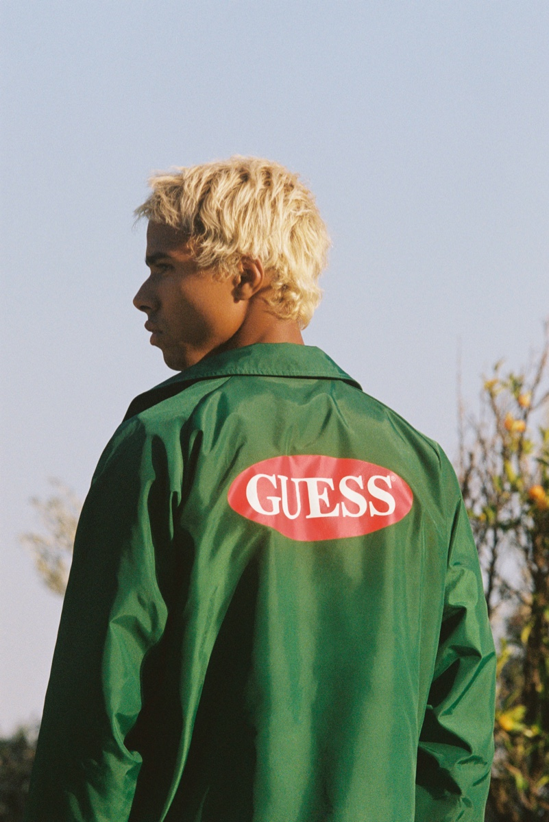 Sporting a coach jacket, Daouda Ka appears in GUESS Originals' fall 2020 campaign.