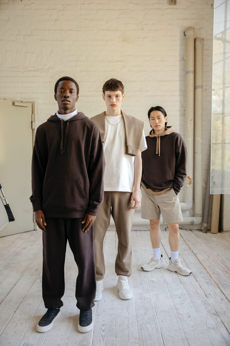 Sunday Romuald, Louis Göckenjan, and Why Be don pieces from H&M's Blank Staples collection.