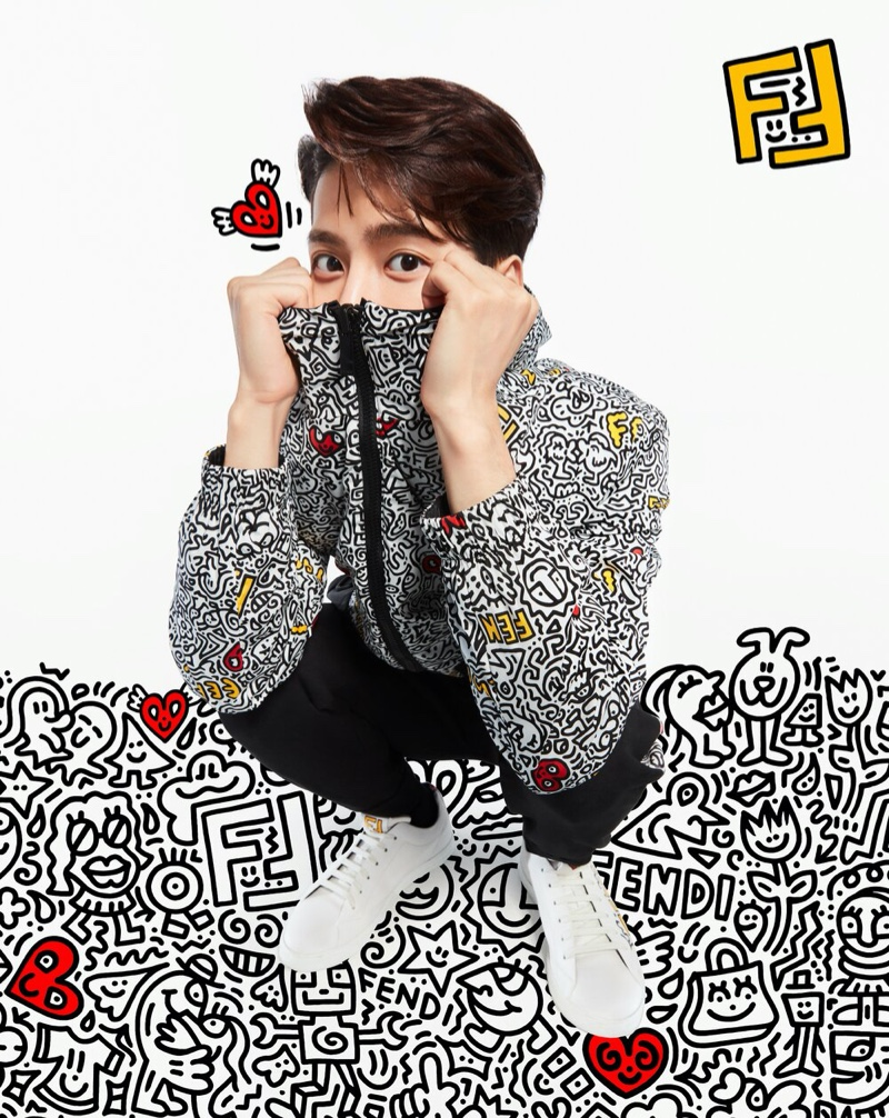 Embracing a sporty appeal, Jackson Wang dons a printed track jacket from Fendi's Mr. Doodle capsule collection.