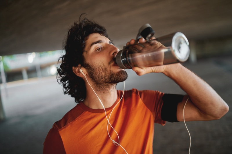 Man Drinking Reusable Water Bottle