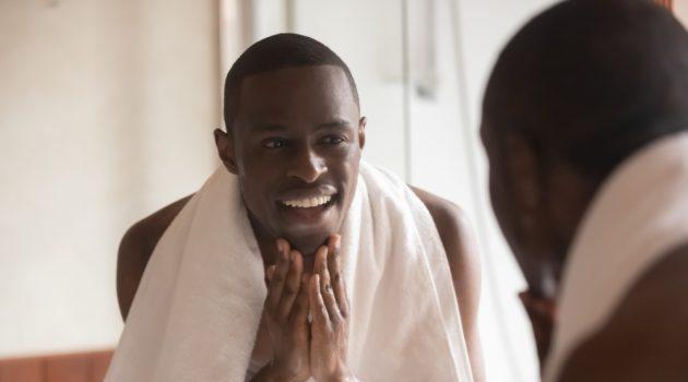 Man Smiling Washing Face