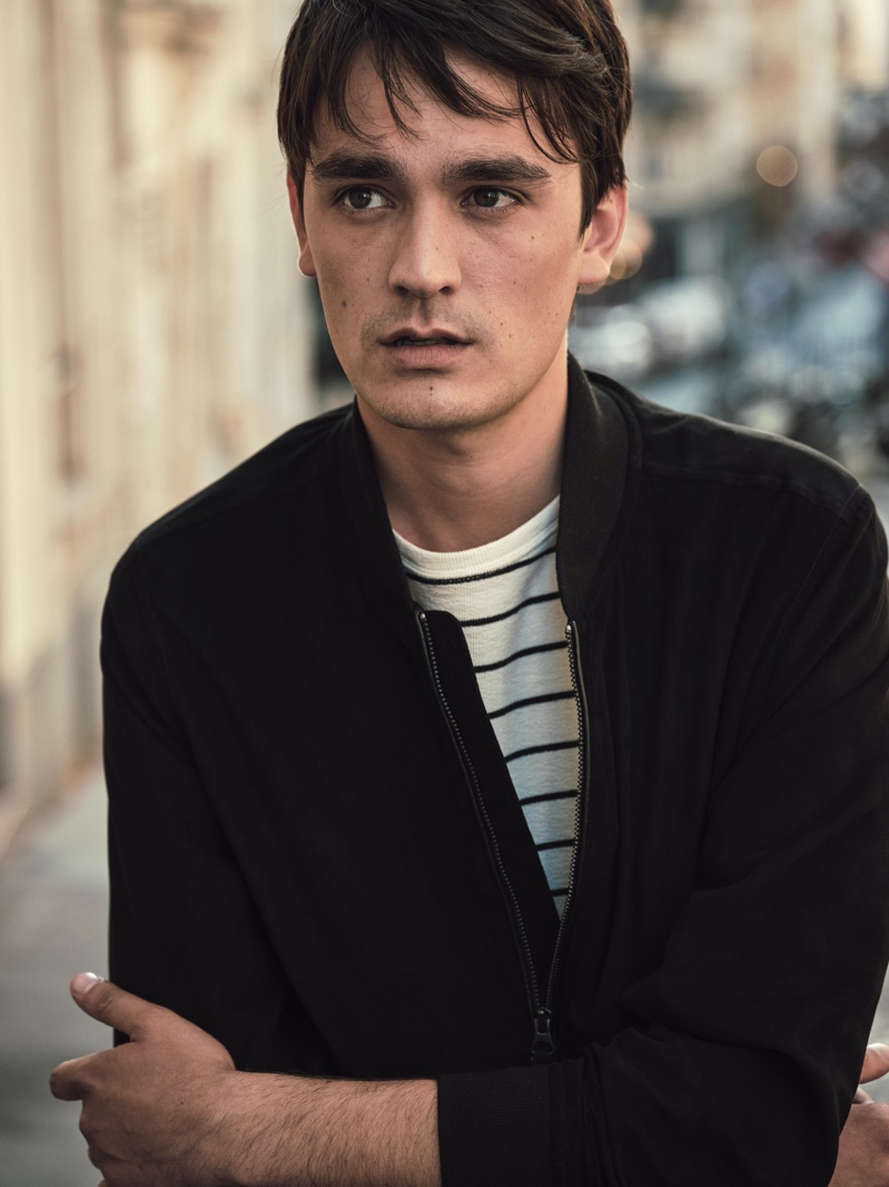 Connecting with Mango Man for fall-winter 2020, Alain-Fabien Delon wears a bomber jacket with a striped pullover.