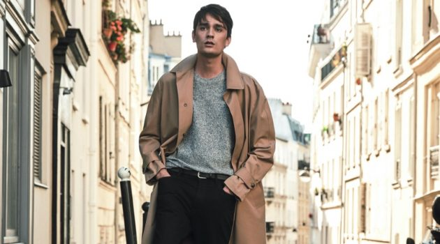 Stepping outside into the Parisian streets, Alain-Fabien Delon sports a trench coat and more essentials from Mango Man.
