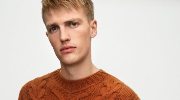 Victor Nylander dons a brown cable-knit sweater from Marc O'Polo's fall-winter 2020 casual collection.