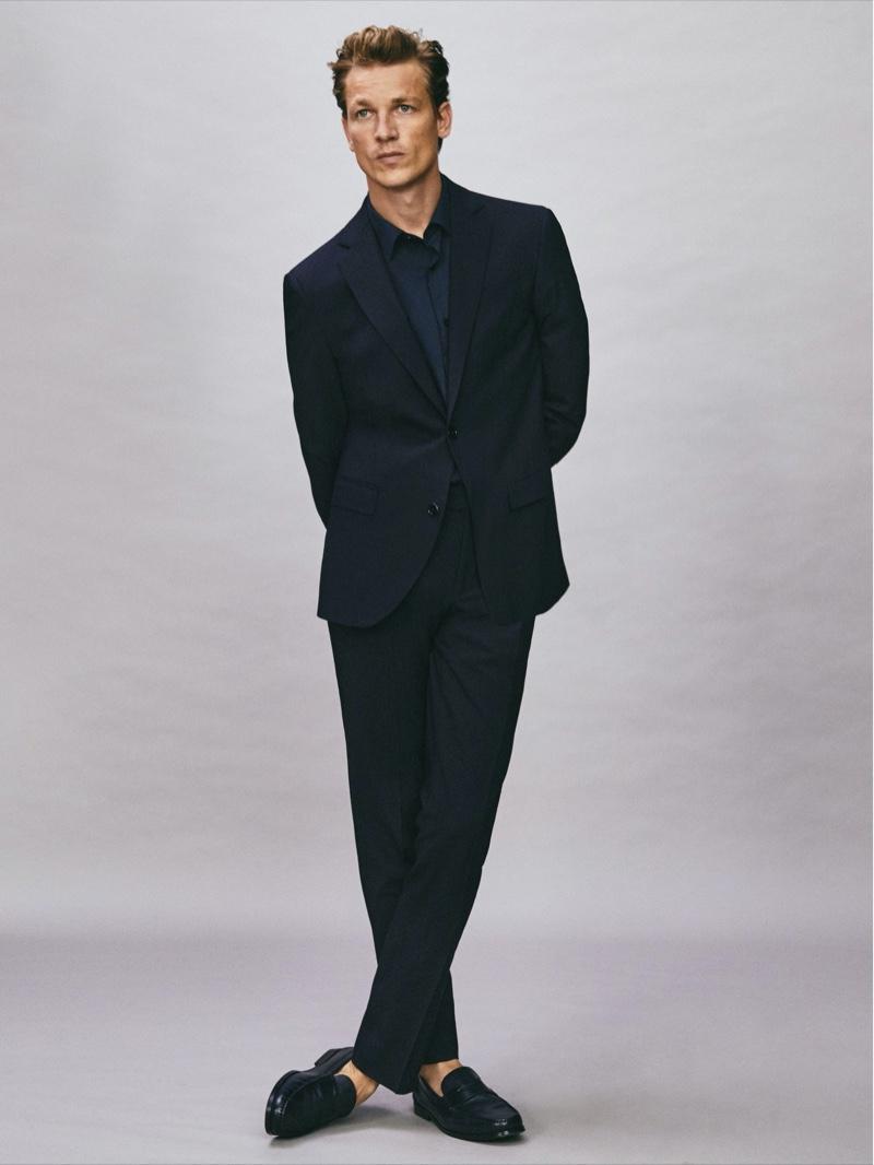 Taking to the studio, Hugo Sauzay sports Massimo Dutti's comfort slim fit navy suit.