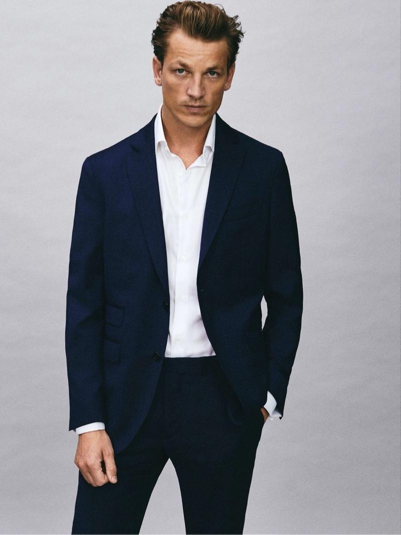 Embracing a sartorial flair, Hugo Sauzay wears a Massimo Dutti slim fit super 120's wool textured weave blazer.