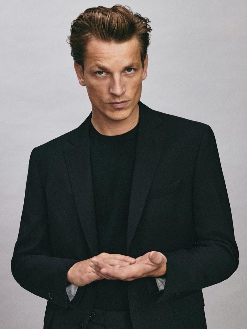 French model Hugo Sauzay dons a black wool slim fit blazer from Massimo Dutti.