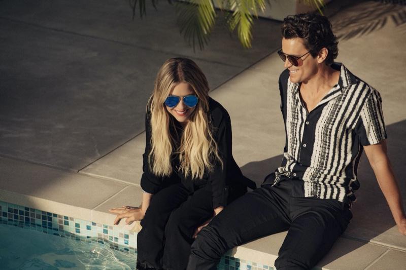 Relaxing poolside, Ashley Benson and Matt Bomer sport Privé Revaux Cliffs sunglasses.