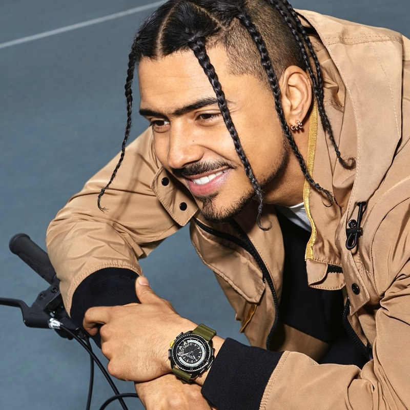 All smiles, Quincy Brown fronts Coach's C001 watch campaign.