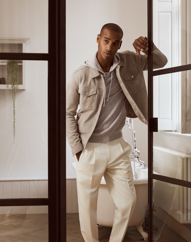 Embracing a wardrobe of neutrals, Sacha M'Baye wears a Jagger jacket with a Santiago hoodie and Monk trousers from Reiss.