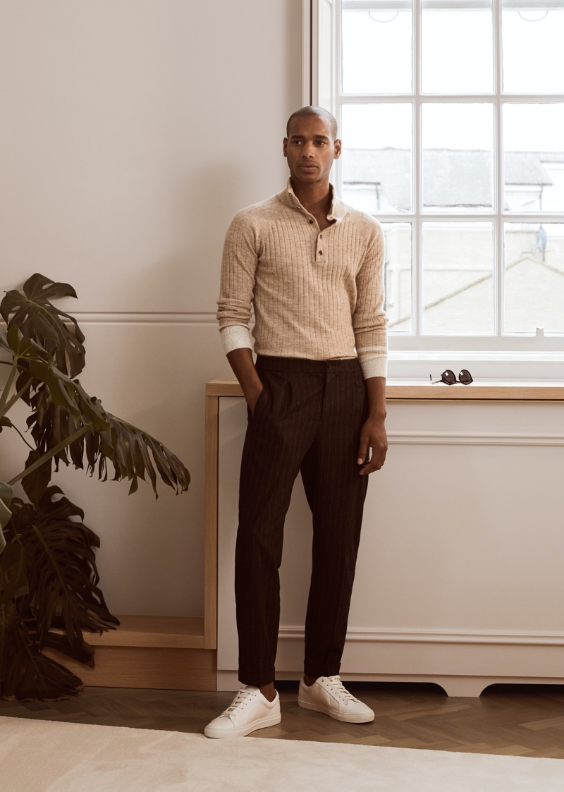 Front and center, Sacha M'Baye models Reiss' Aiden sweater, Tower trousers, and Luca sneakers.