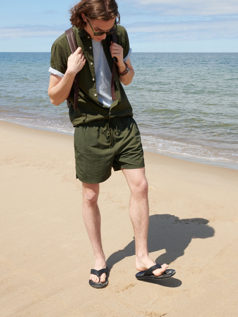 Making a case for monochromatic style, Pawel Feledyn models a green swimwear look from Reserved.