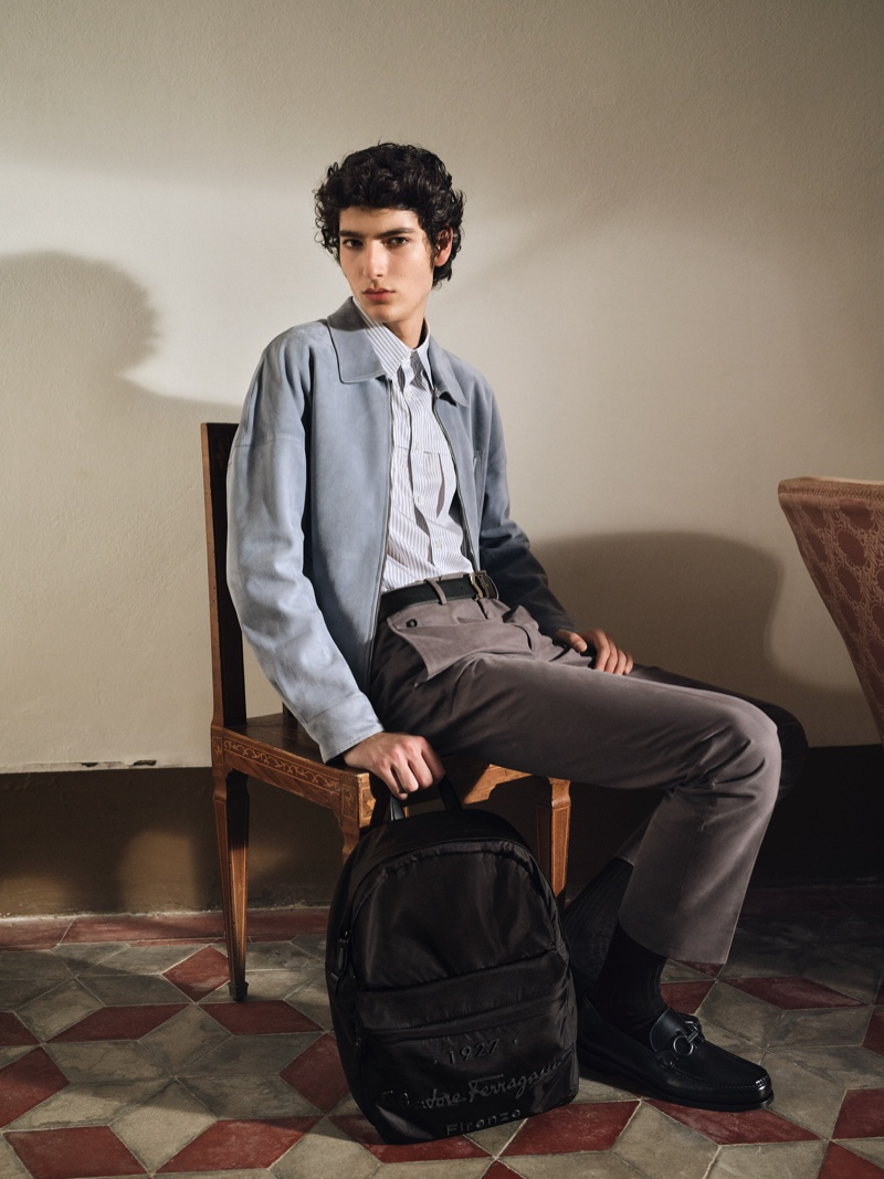 Sitting for a portrait, Mario Lopez takes hold of a backpack from Salvatore Ferragamo's Tornabuoni 1927 collection.