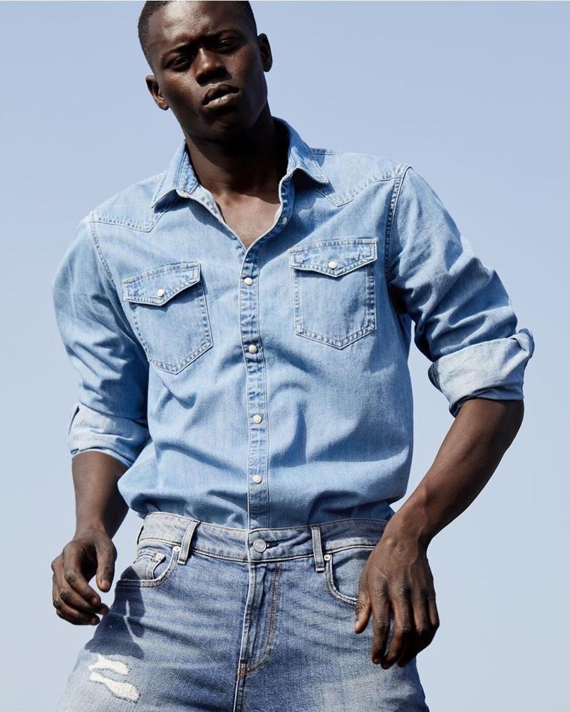Doubling down on denim, Alpha Dia wears a look from Scotch & Soda's Amsterdams Blauw label.