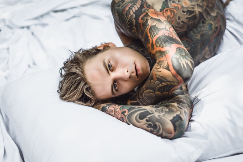 Tattooed Man in Bed Shirtless