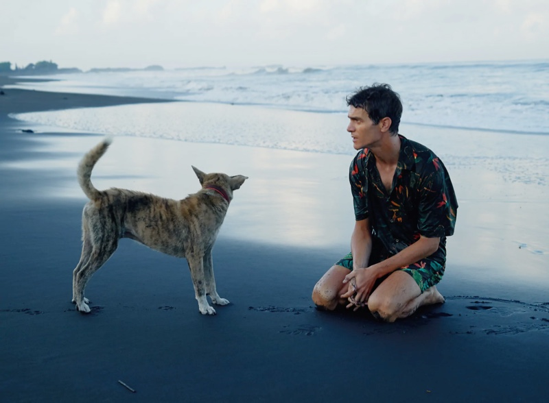 French model Vincent Lacrocq takes to the beach in a matching leaf print shirt and swim shorts by Zara.