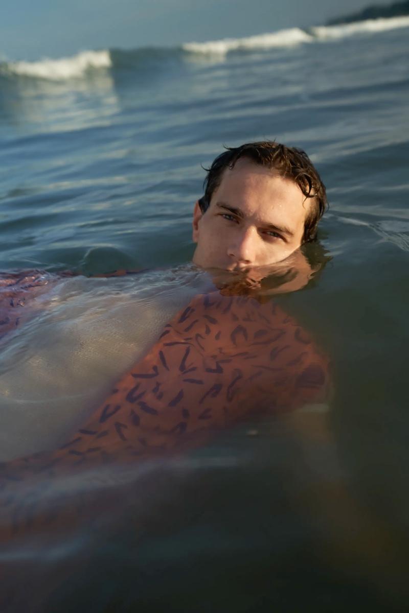 Taking a dip, Vincent Lacrocq wears a geometric print shirt from Zara.