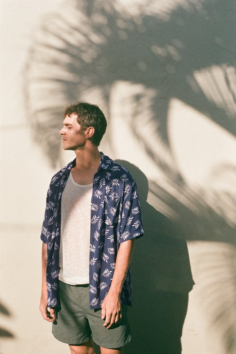 Basking in the sun, Vincent Lacrocq models a leaf print shirt from Zara.