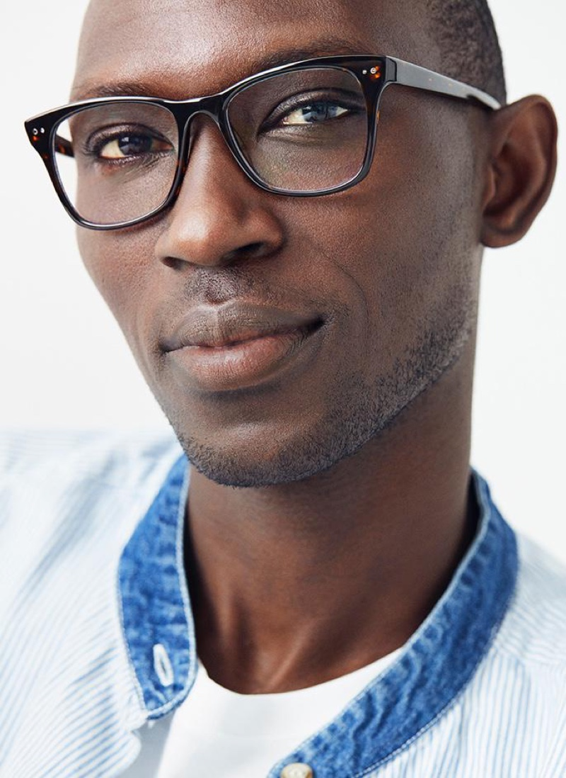 A smart vision, Armando Cabral models Warby Parker's Landon glasses in whiskey tortoise.