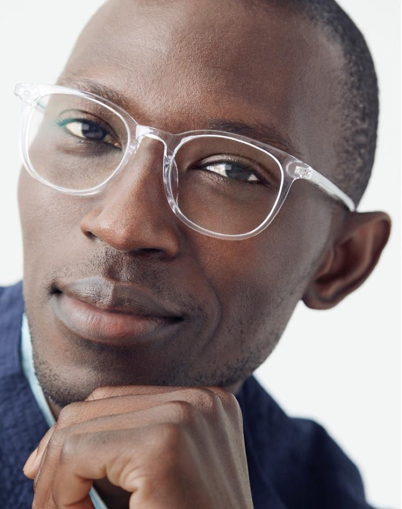 On trend, Armando Cabral sports Warby Parker's Durand low bridge fit glasses in crystal.