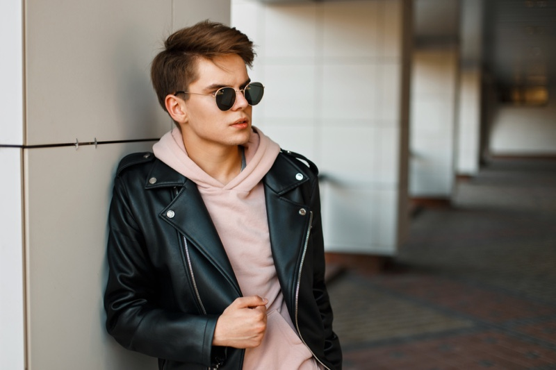 Young Man Leather Jacket Pink Hoodie Sunglasses