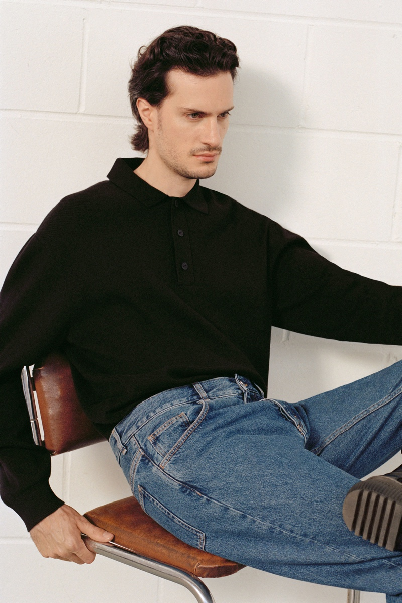 Delivering a side profile, Tristan Pigott wears a long-sleeve polo from COS with regular fit recycled cotton jeans.