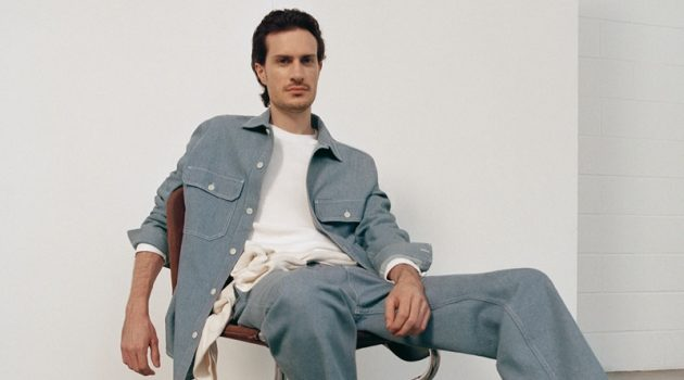 Figurative artist Tristan Pigott connects with COS for fall. He poses in the brand's organic cotton utility-style denim overshirt with a pair of recycled cotton denim cargo trousers.