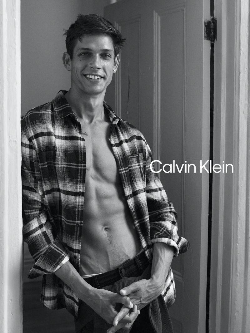 All smiles, Ethan James Green wears a plaid shirt with jeans for Calvin Klein's fall 2020 #MyCalvins campaign.