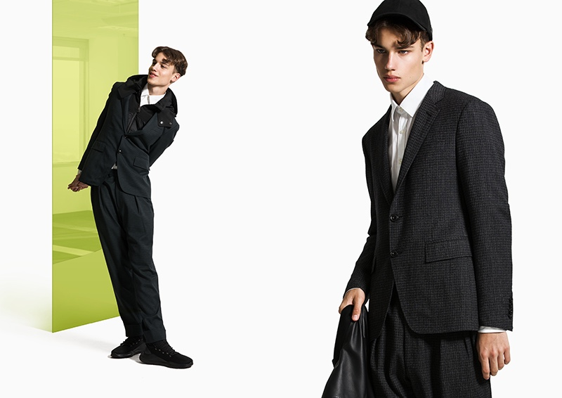 Modeling looks from Canali Black Edition, Carlo dons relaxed tailoring with a sporty attitude.
