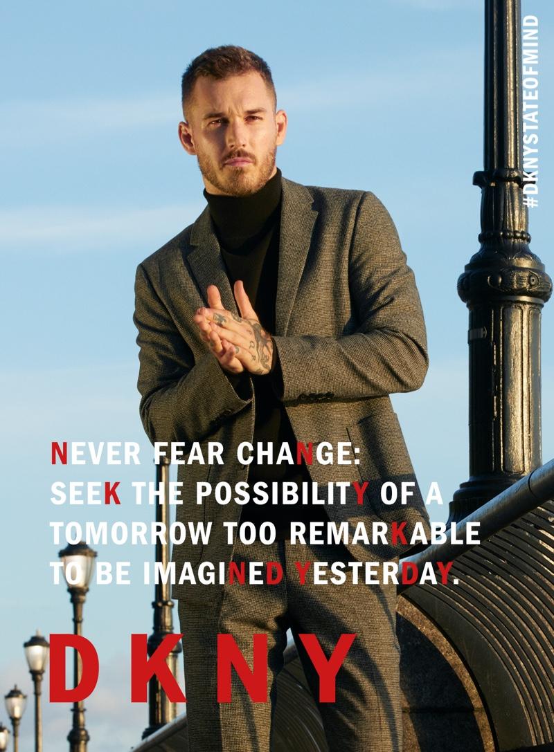 Donning a contemporary suit, David Alexander Flinn stars in DKNY's fall-winter 2020 men's campaign.