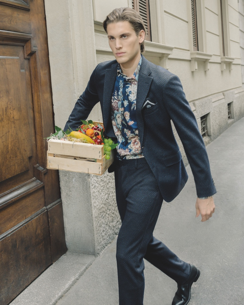 On the move, Maxime Trabouile sports Etro's 24 Hour jacket in a micro-geometric print.