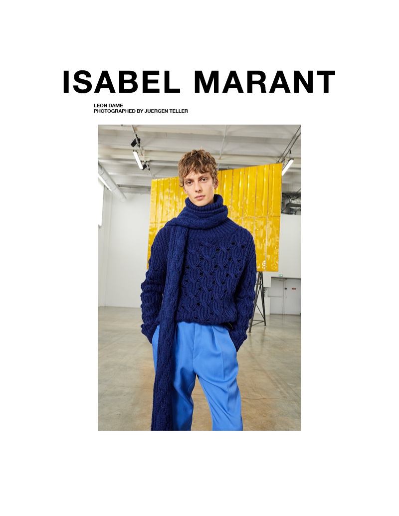 Leon Dame dons a matching cableknit scarf and sweater with pleated trousers for Isabel Marant's fall-winter 2020 campaign.