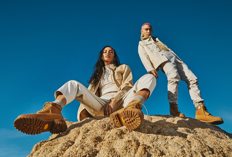 Traveling out to the Californian desert, Evan Mock and Kristen Noel Crawley front the Jimmy Choo x Timberland campaign. The pair dons wheat gold nubuck with glitter spray boots.
