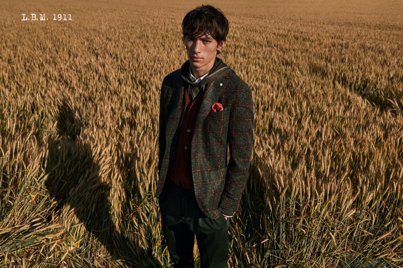 Front and center, Eliot Moles le Bailly wears L.B.M. 1911.