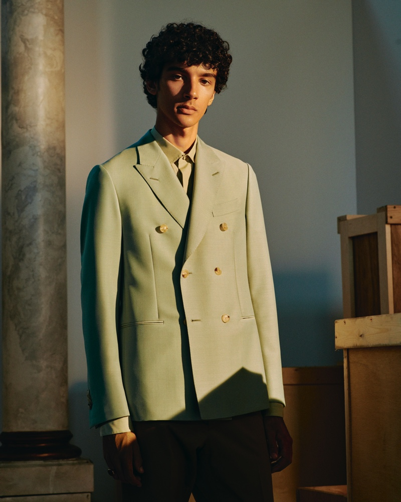 Suiting up in Caruso, Callum Stoddart models a double-breasted wool and mohair-blend blazer with a cutaway-collar cotton shirt from Mr Porter's Italian Masters collection.