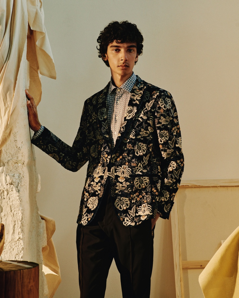 An elegant vision, Callum Stoddart models an Etro embellished velvet tuxedo jacket with a printed cotton shirt and tapered wool trousers from Mr Porter's Italian Masters collection.