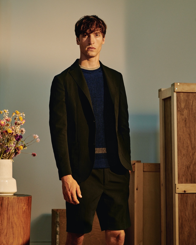 Donning a short suit, Tim Dibble wears an Incotex Urban Traveler slim-fit tech-twill suit jacket and and shorts with a striped ribbed cotton-blend sweater from Mr Porter's Italian Masters collection.