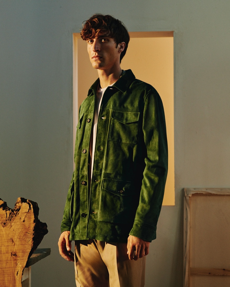 Front and center, Tim Dibble sports a green suede field jacket from Mr Porter's Italian Masters collection.