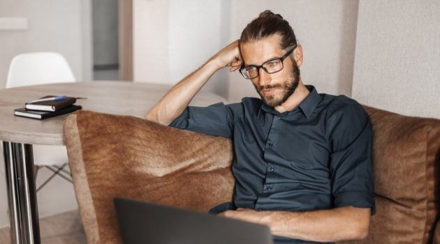 Male Model Laptop Couch Glasses Man Bun