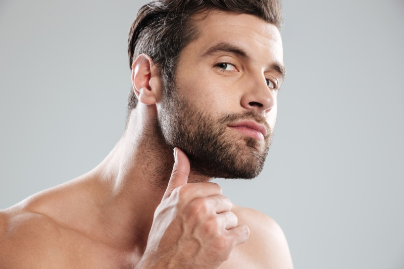 Male Model Touching Beard Grooming