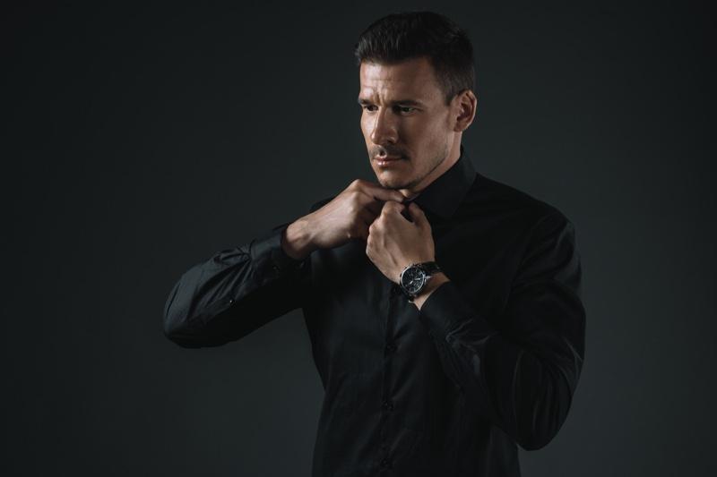 Man Buttoning Up Shirt Watch Black