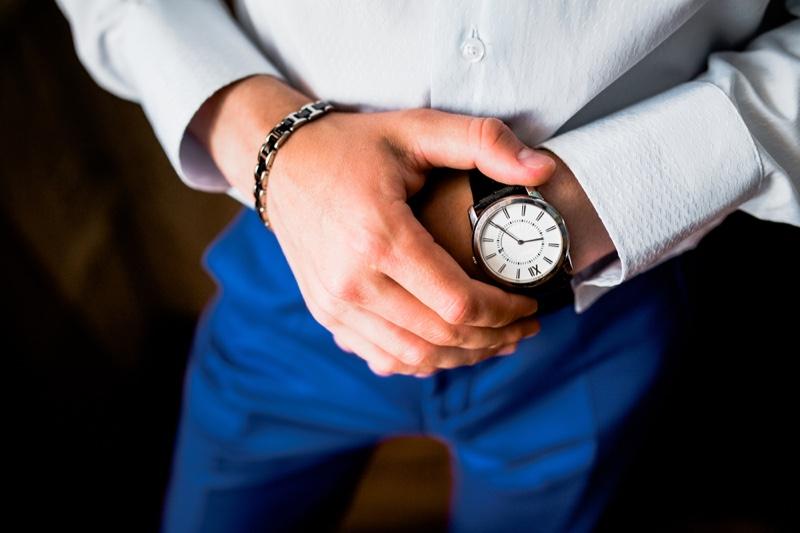 Man Checking Watch Silver Bracelet