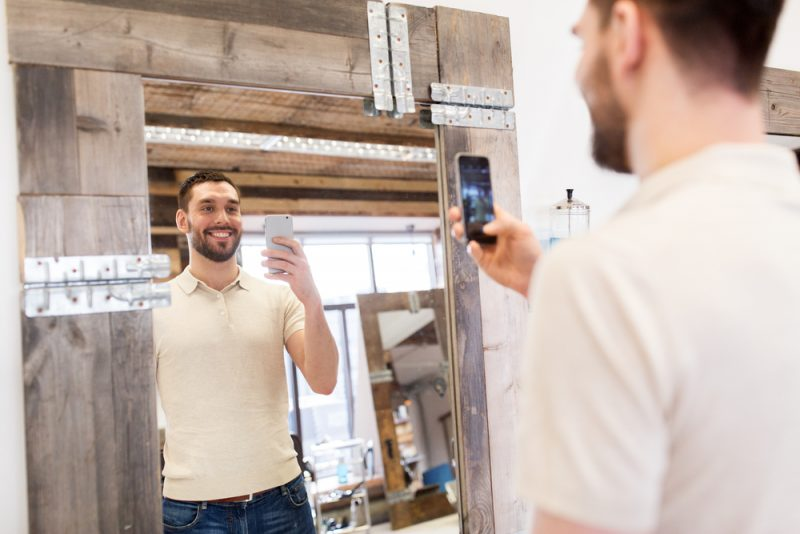 Man Taking Picture in Mirror