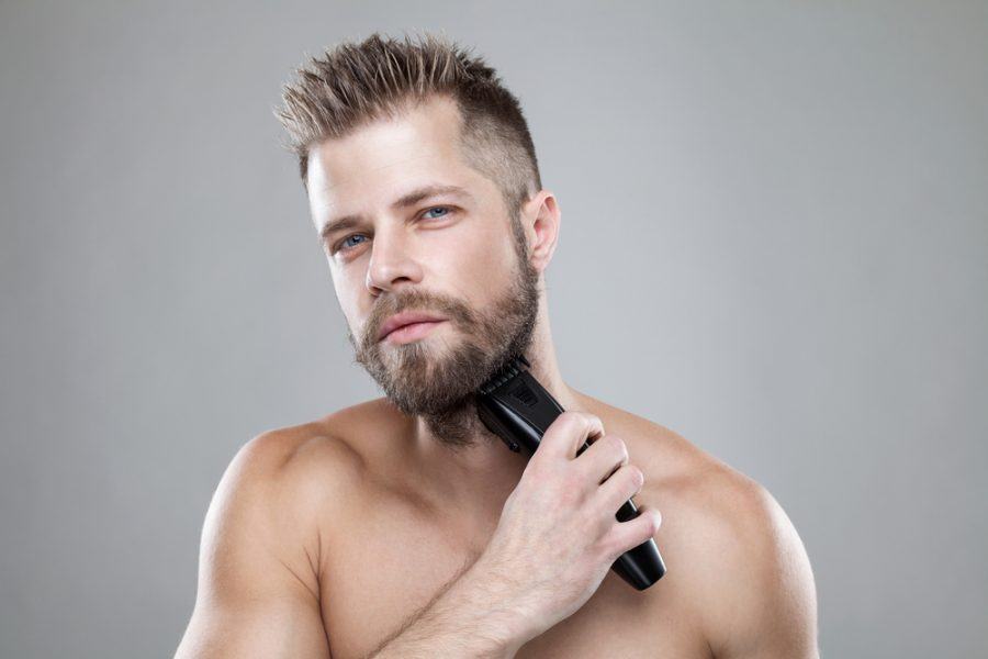 Man Trimming Beard